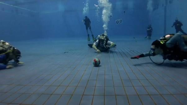 The Russian divers playing rugby under water
