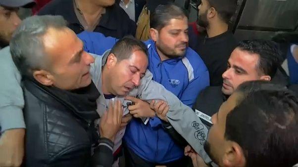 فلسطيني يقع مغشيا عليه من أثر الصدمة غزة