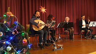 حفل موسيقي في برلين لأداء أناشيد الميلاد بالعربية