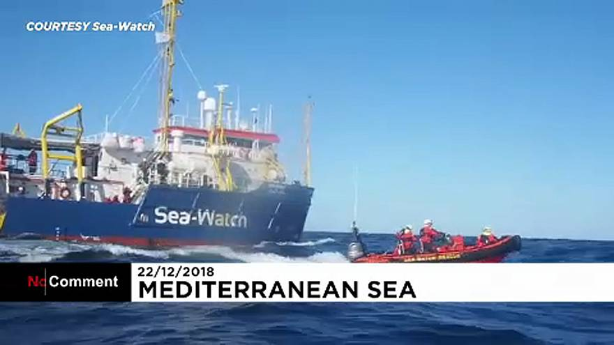 Dozens of rescued migrants stranded at sea wait for safe port