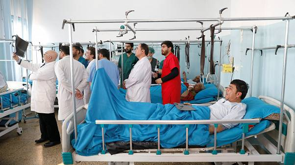 Injured men at the hospital after an attack in Kabul, Dec 25, 2018.