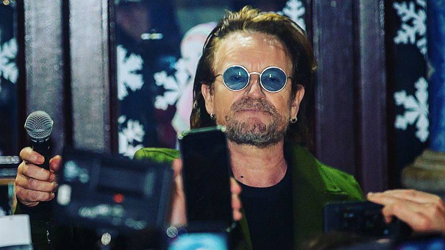 Watch: Bono and The Edge busk to raise money for homeless charity in Dublin