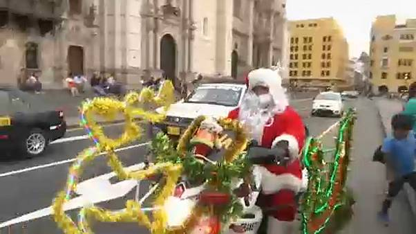 Peru police dress as Santa and the Three Wise Men