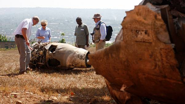 French investigators examine the wreckage of Juvenal Habyarimana's plane