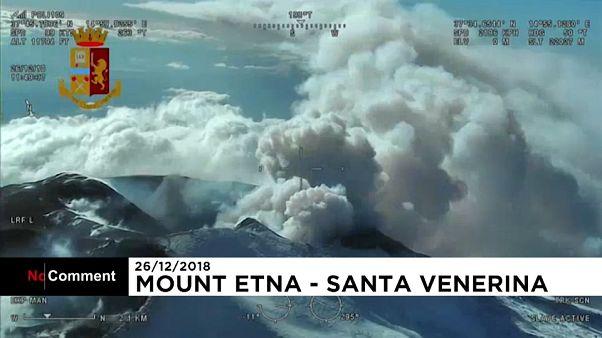 Aerials of Mount Etna erupting and damaged village