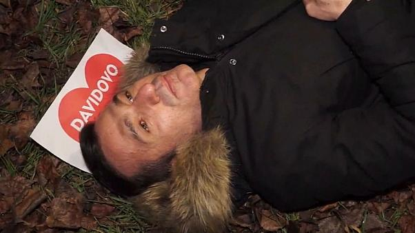 Davor Dragicevic, David's father, lying in place where his son was killed.