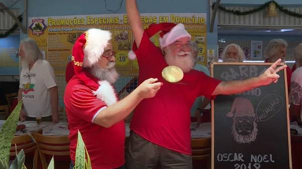 Rio's Santa Claus school graduates celebrate with a beard trim