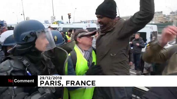 Yellow vest demonstrators clash with police in Paris