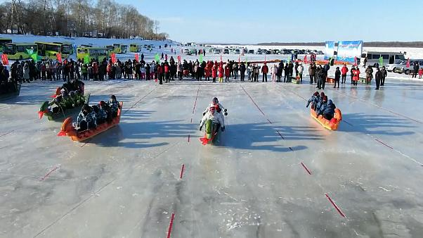 Chinese and Russian dragon boats battle it out on the ice