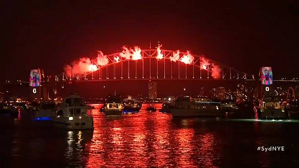 Sydney harbour illuminated by New Year fireworks