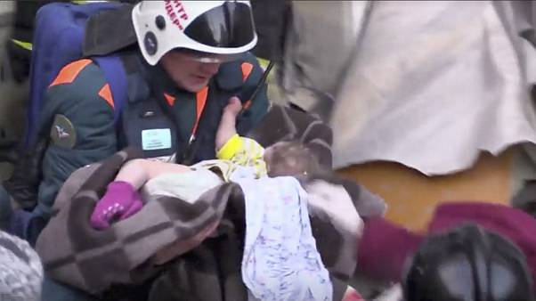 Watch: 'Miracle baby' pulled from rubble as number of dead in building collapse rises to 21