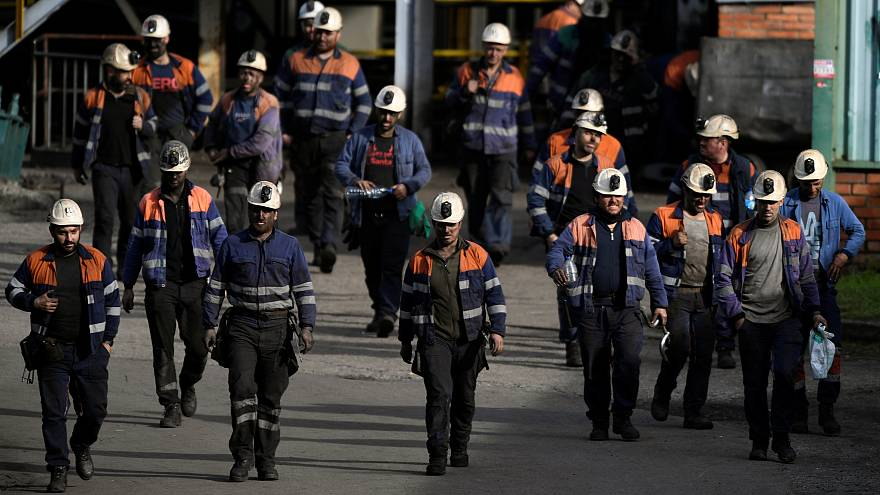 Coal miners leave the mine Pozo Santiago after finishing their shift