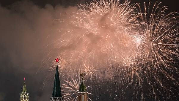 Fireworks explode in the sky over the Kremlin during New Year celebrations