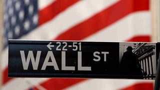A Wall Street sign is seen outside the New York Stock Exchange