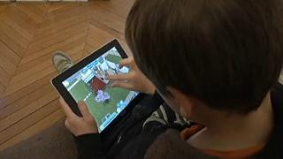 A child watching a screen.