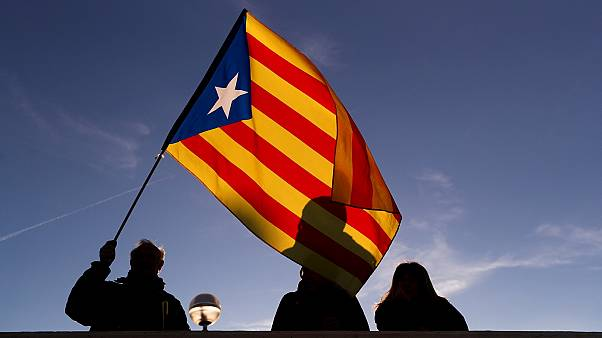A protester waves the Catalan Estelada flag in Barcelona.
