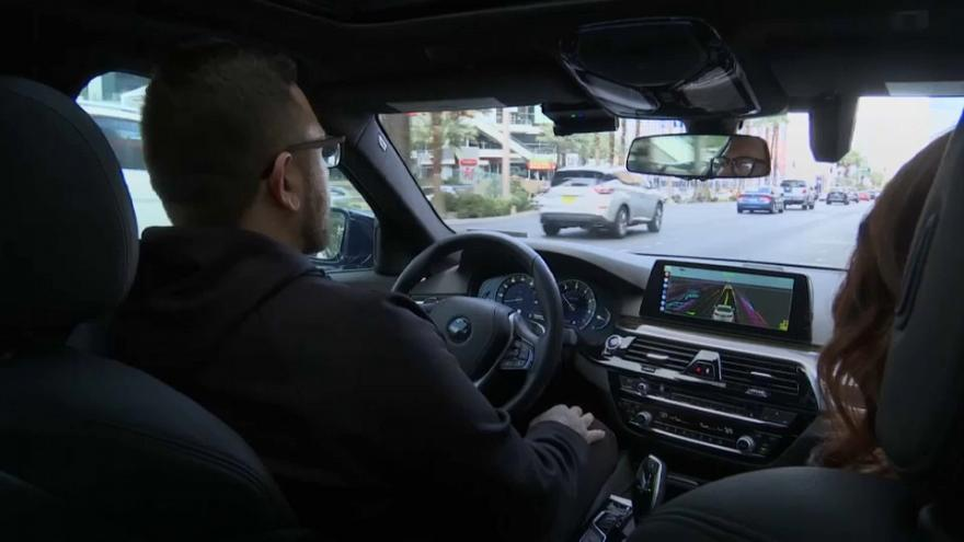 Self-driving taxi service takes to Las Vegas streets