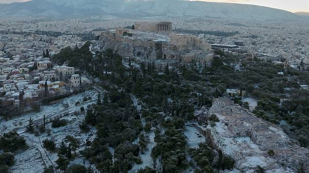 Watch: Athens awakes to winter wonderland