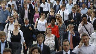 Commuters walk across London Bridge to the City of London August 7, 2013.