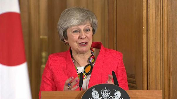 UK PM May speaking at a press conference alongside Japanese counterpart Abe