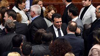 Prime Minister Zoran Zaev greets MPs after the vote.