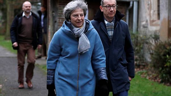 Theresa May leaves church near High Wycombe with husband Philip.