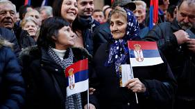 Thousands gather in Belgrade to cheer Putin during his brief visit to Serbia