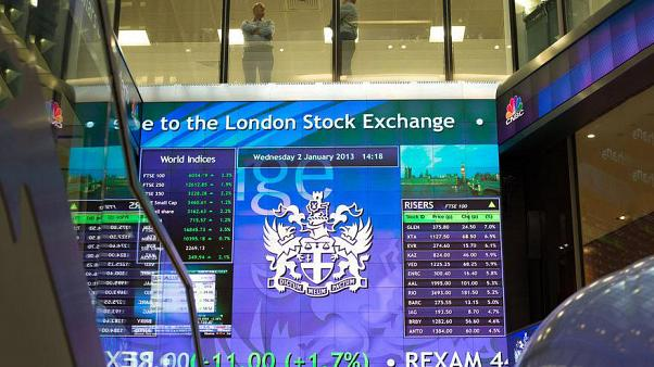 British stocks shrug off politics as results drive big moves