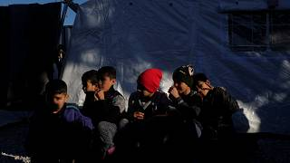 Poor conditions in migrant camps can pose health concerns, WHO says