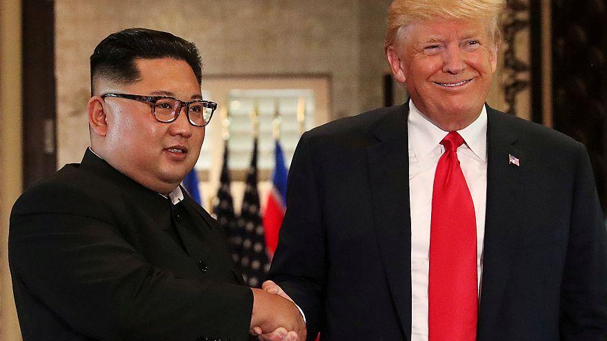 Donald Trump and Kim Jong Un in Singapore June 12, 2018.