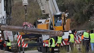 Engineers work to rescue a boy trapped down a borehole in southern Spain