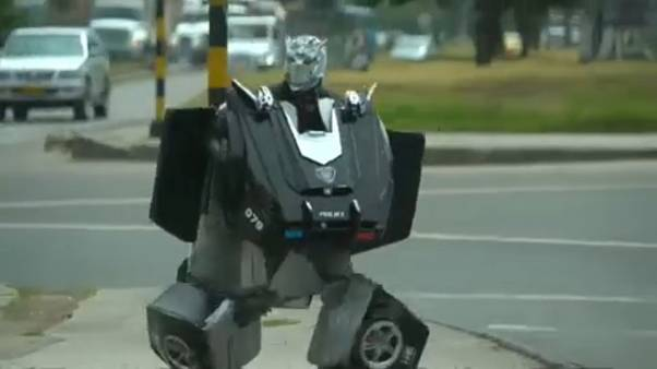 "Beggar dressed as a ""Transformer"" on a Bogota street"