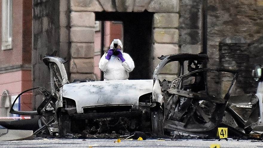 A forensic officer at the scene of a suspected car bomb in Londonderry.