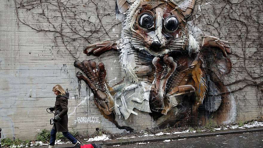 This street art is raising attention to endangered animals and it is made of plastic waste