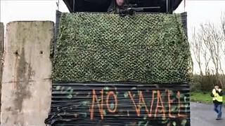 Raw Moment: Protesters dressed as soldiers create 'Brexit border wall' on island of Ireland