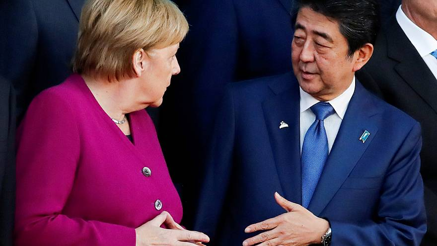 German Chancellor Angela Merkel and Japan's Prime Minister Shinzo Abe talk