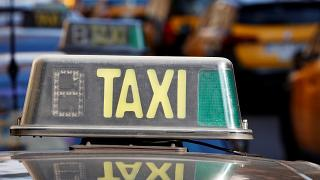 A taxi is pictured in Barcelona during a protest against ride-hailing apps.