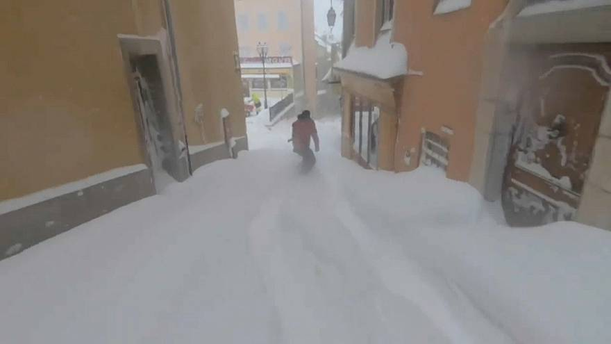 Young snowboarders show off their skills on French streets