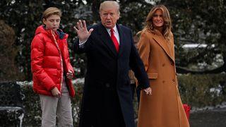 Donald Trump and his son, Barron, left.