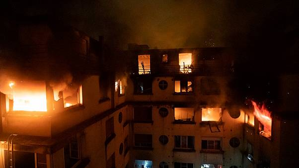 Paris apartment fire: French capital 'in mourning' after 10 killed in blaze