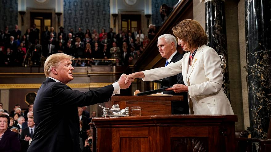 US President Donald Trump shakes hands with House Speaker Nancy Pelosi