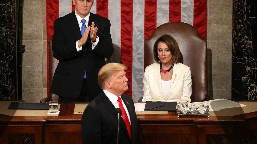 Mike Pence applauds as Nancy Pelosi looks on