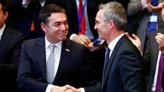 Macedonian FM Dimitrov shakes hands with NATO Secretary General Stoltenberg