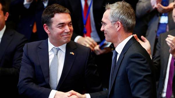 Macedonian FM Dimitrov shakes hands with NATO Secretary General Stoltenberg