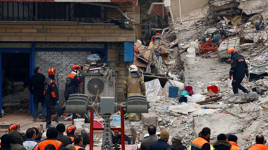 Rescue workers on the site of the building collapse in Istanbul