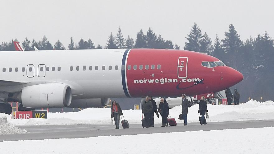 Passengers evacuate Norwegian Air Shuttle plane after bomb threat