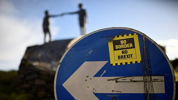 A ' No Border, No Brexit' sticker on a road sign in Londonderry