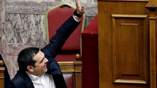 Greek Prime Minister Alexis Tsipras votes during a parliamentary session on