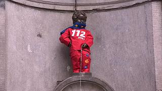 Manneken Pis dons European Emergency Number Association costume for 112 Day