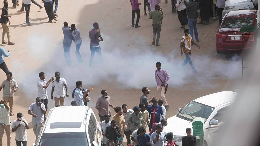 Tear gas is fired by police at an anti-government protest in Khartoum